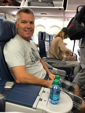 Delta Air Lines: My husband enjoying his roomy seat in First Class.