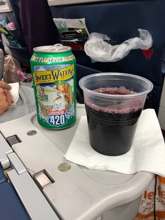 Delta Air Lines: Beer for my husband and red wine for me.