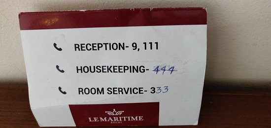Le Maritime: Incorrect and hand-written phone directory in the room