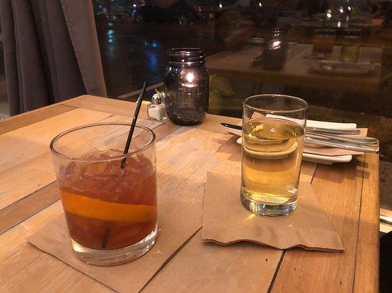 Maple Old Fashioned sitting next to Chardonnay