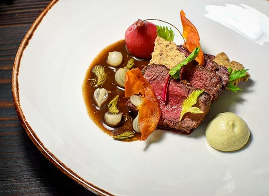 Ballymahon, Ireland: Wild Venison, Juniper Biscuit, Beetroot, Global Artichoke Puree, Reduction of Venison stock finished with 80%Chocolate, Pickled Pine & Peral