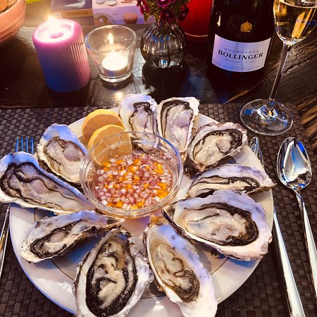 Winter oysters with champagne and paella. Delicious!