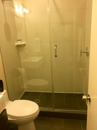 """Bathroom in tiny """"Queen"""" room is OK.  The bathrooms in King suites are NOT remodeled and are less than half this size!"""