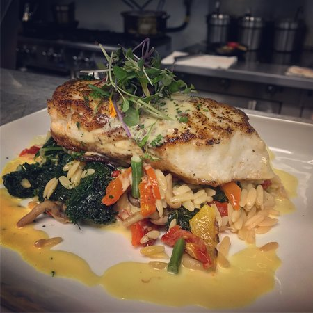 Pan seared fresh Halibut over an orzo/vegetable sauté. Finished with a charred lemon saffron cream sauce.