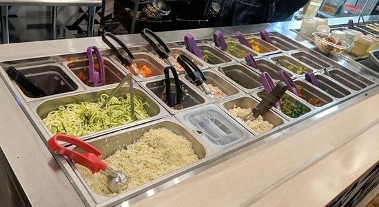 Subway or salad bar style cold bar.