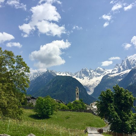 Soglio and the bell tower of the Kirche San Lorenzo seen from afar.