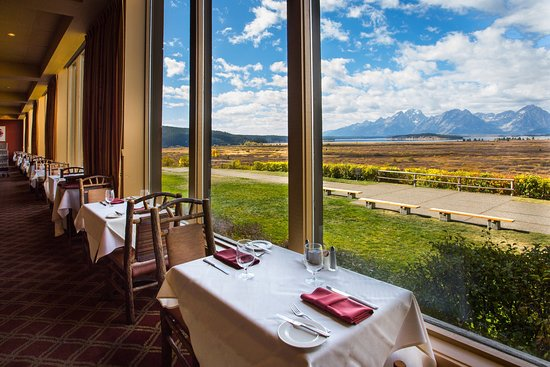 Every table features panoramic views of the Teton Mountain Range and the Willow Flats.