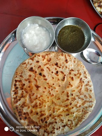 Aloo paratha served piping hot with curd and green chutney