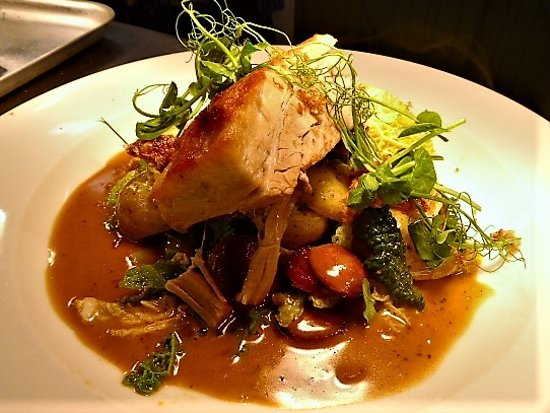 Minster Lovell, UK: It's not just fish that we do! Old spot belly of Pork, winter greens and a Dijon jus.