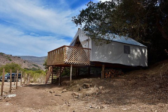 La Mision, Mexico: This is one of the safari style tents. This one has king bed, writing desk, pull out sofa, chairs indoor facilities except shower. Private showers are available in a group facility