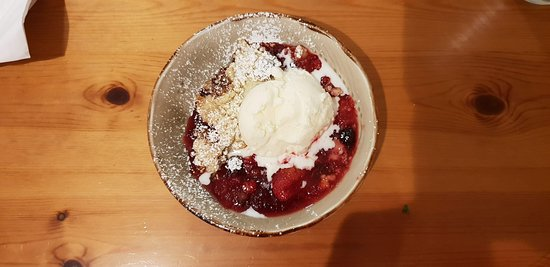 Scourie, UK: Fruit Crumble - fruit stew with a handful of crumble, heated (probably under the grill) and served with a scoop of ice cream. Tasted ok, however specific fruit crumble would be better.