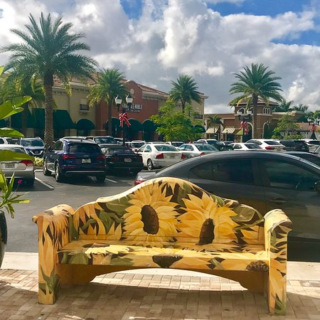 there are benches decorated - Barnes And Noble Shops At Pembroke Gardens