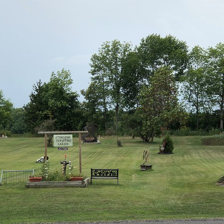The sculpture garden is on Route 9, south of Plattsburgh and north of Ausable Point State Campground.  It is very close to the Peru Boat Launch and Valcour Island..