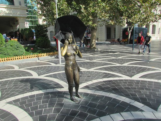 Sculpture Girl with Umbrella