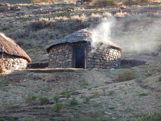 Major Adventures The Sani Pass Specialists: A cooking fire in a stone house.