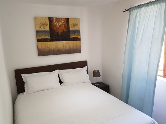 Room 9 accommodates 4 adults in two separate rooms with 2 queen beds. En-suited with mini-fridge, DSTV, ironing facilities, hairdryer, tea/coffee, guest amenities etc..
