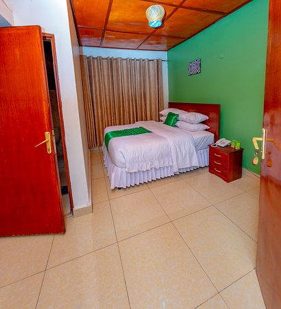 Kigali Province, Rwanda: Ideal for one to two people. All rooms have double glazing, ensuring a calm and relaxing environment for our guests. Double rooms have a large double bed (1.90 m per 1.60 m).    Room Facilities: Telephone, A work desk, Shower, Toilet, slippers, Bathroom, Room service, Wake-up service.