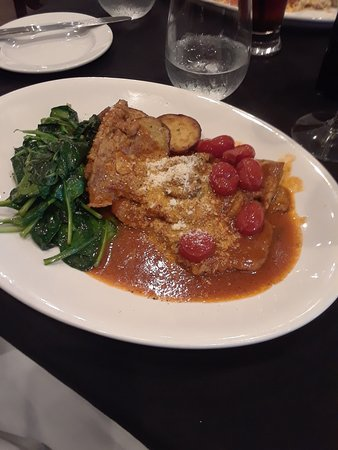 Vincenzo Cucina Italiana: Nice plate presentation was the end of anything good for this dish my wife had.  Way way over salty so ruined the dish.