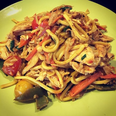 Mild creamy curried chicken and vegetables with egg noodles