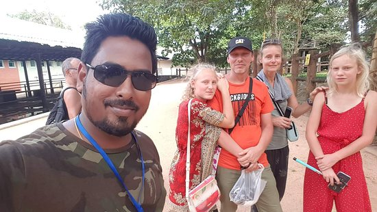 Lanka Beach Holidays: We and our fantastic guide Praveen in Pinnawela.
