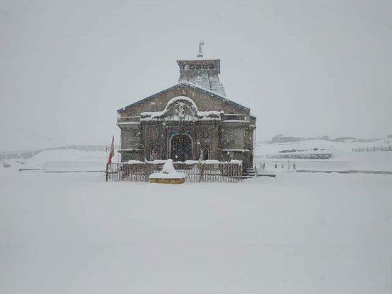 Kedarnath temple covered in snow.