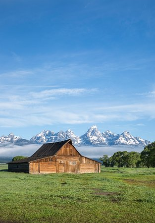 Kelly, WY: One of the most photographed scenes in Grand Teton National Park is of the old barns on Mormon Row. The area, also called Antelope Flats or Gros Ventre, includes a stretch of road with multiple buildings established in the early 1900s. The barn pictured is on the T.A. Moulton farm just down from John Moulton's farm. Both barns make a dramatic foreground to the Teton Mountain Range at sunrise. PC: Grant Ordelheide