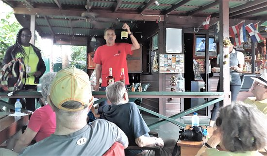 The owners are a couple.  The husband does the rum tasting (center) while teaching the audience about rum.  The wife (hidden by the post on the right) is the cook, and serves the rum.