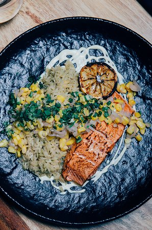 SALMON Creamed corn purée, roasted atlantic salmon served with a corn relish and a coconut milk, lime, ginger and poblano sauce.