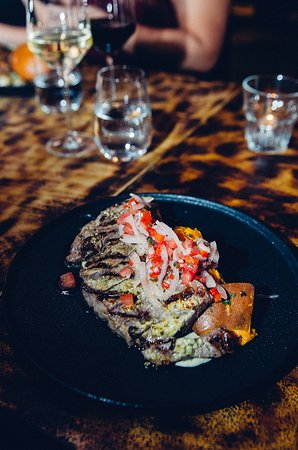 BEEF SKIRT 8oz All of our steaks are AAA Angus beef certified and served with a chimichurri yogurt, avocado crema salt baked potatoes and a salsa criolla.