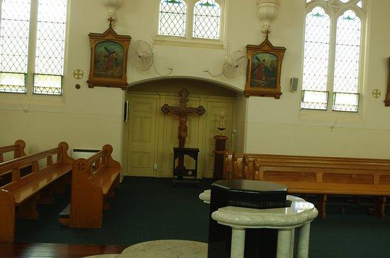 St Joseph Catholic Church: Crucifix to side of baptismal font