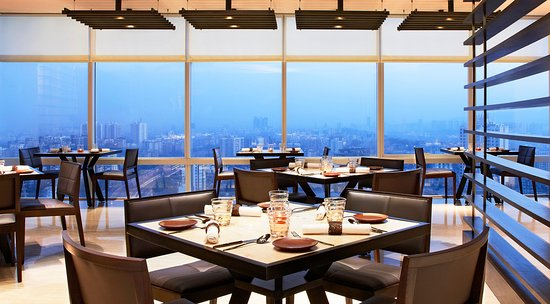 Kangan: Enjoy panoramic views of the city skyline while savoring delicious melt in the mouth kebabs.