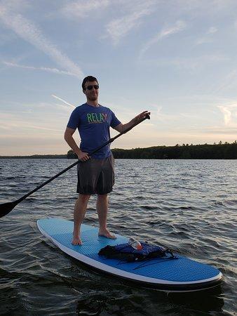 Raymond, ME: Paddle boarding at sunset on Sebago Lake