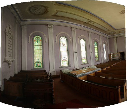 "Interior of Readfield Union Meeting House, showing its renowned trompe l'oeil (""fool the eye"") interior painting on walls and ceiling.  The artwork, pews, woodwork and several windows remain as they were originally placed in 1868."