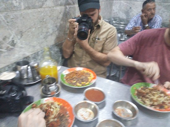 with our Guest eating like locals the most delicious popular dash in Egypt Koshary at local Resturant in Cairo