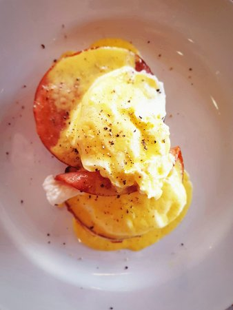 Eggs Benedict served on a fresh english muffin with savoury ham