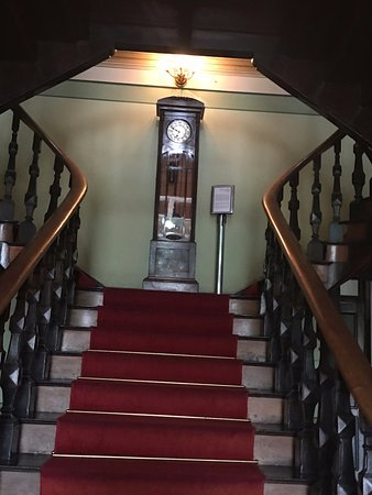 Palacio Rio Negro clock at top of staircase