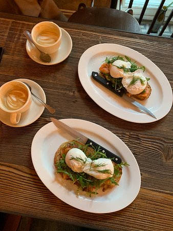 bread with poached eggs, cappuccinos