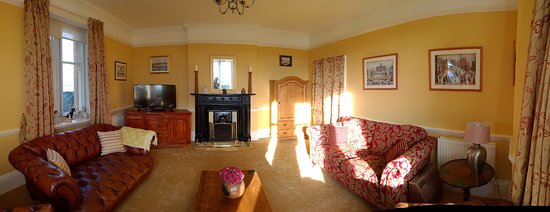 Cornhill-on-Tweed, UK: This is the guest sitting room with open fire, Sky TV and Netflix.