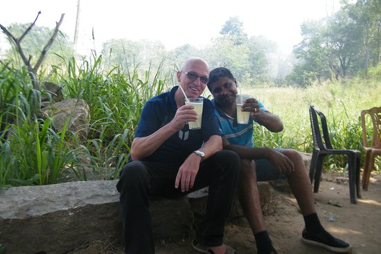 Tour with Mr Voigt to Mirissa Beach Via Udawalawa National Park. Enjoying a glass of natural fresh orange juice from wellawaya .