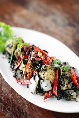 Squid stir fry with black Kampot pepper.