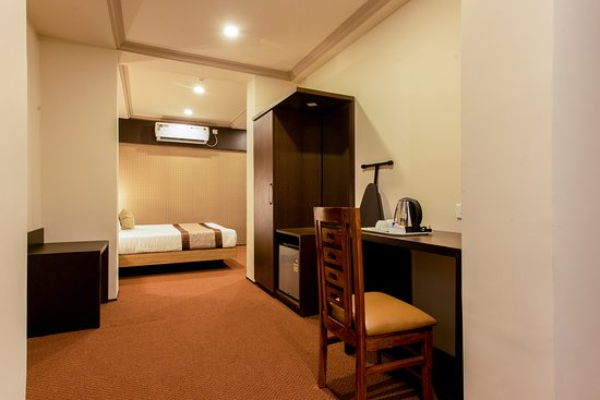 Hotel Anthurium Circle: Executive Room: Spacious and Fully Air Condiitoned with Free wifi, room service, Electronic safe deposit Locker, hair Drier, Electric Kettle,Aromatherapy Toiletries,Iron with Iron Board,