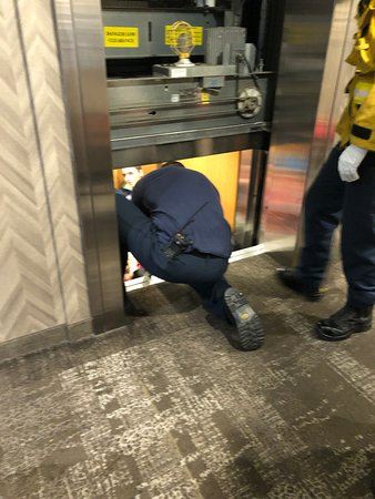 Hotel Elevator Stuck between 1 & 2nd Floor. Firefighters had to pry doors apart to get guests out. Management did not care at all.