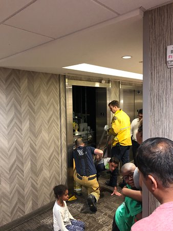 Firefighters Rescuing Hotel Guests from Elevator that was stuck between floors.