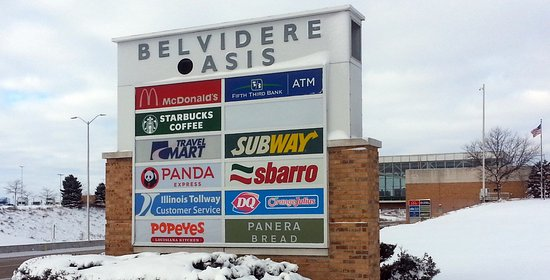 sign for all of the restaurants, including Popeye's. at the Belvidere Oasis