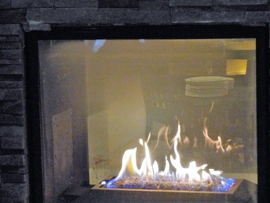 Granite City Food and Brewery: Nice Fireplace in our Dining Area