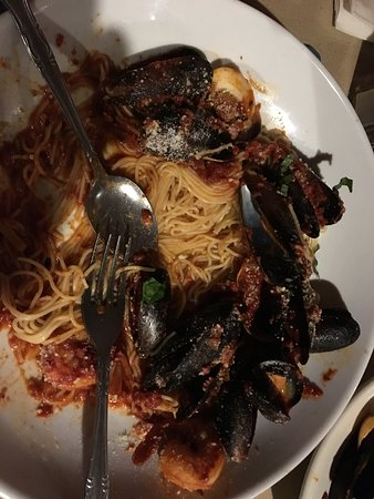 Miller Place, NY: Suop da Pisca Thing spaghetti, muscles, clams, shrimp with a Marinara sauce.. AMAZING!!! I could not wait to take a picture so its partially eaten..