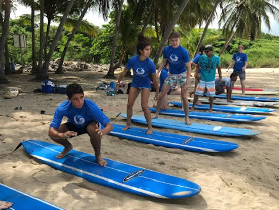 Brasilito, Costa Rica : We provide the  experience, board, rash guard, water and fresh fruit, You bring your enthusiasm and we will have you up on the board in no time!