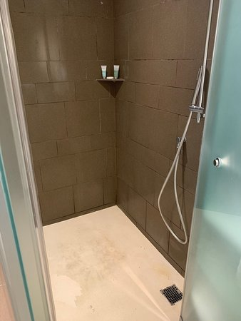 Floor is stained with ??, walls, tile grout is full of mold
