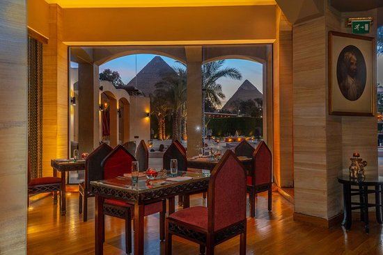 Enjoy your  authentically Indian dinner with remarkable view of the Great Pyramids at Moghul Restaurant