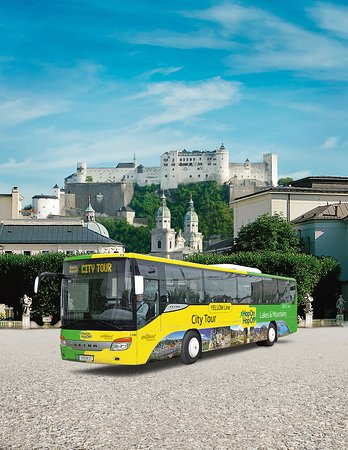Hop on Hop off City Bus in front of Fortress Hohensalzburg.